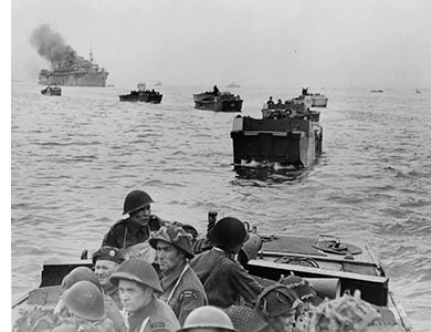 D-Day landings. In the center of the first landing craft a member of the Royal Winnipeg Rilfes (Canada). Ph. LAC, Canada.